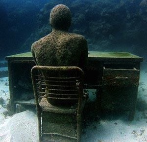 person underwater at desk
